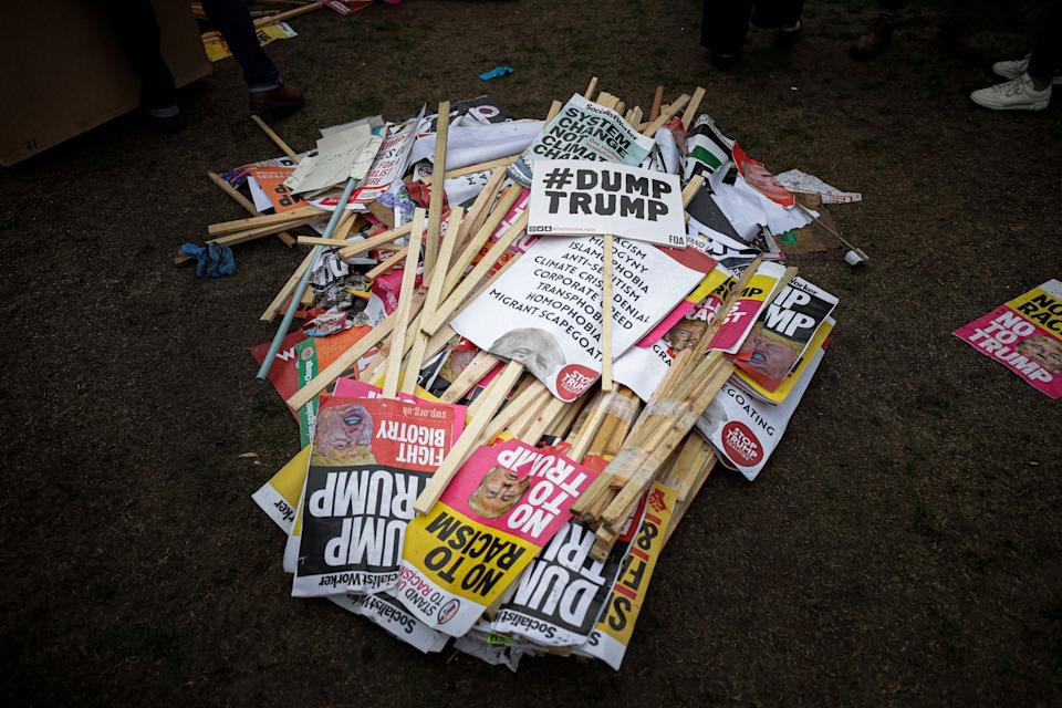 Placards showing anti-Trump messages lie on the ground, in central London, near the end of a protest against the state visit of President Donald Trump,  June 4, 2019. (Photo: Matt Dunham/AP)
