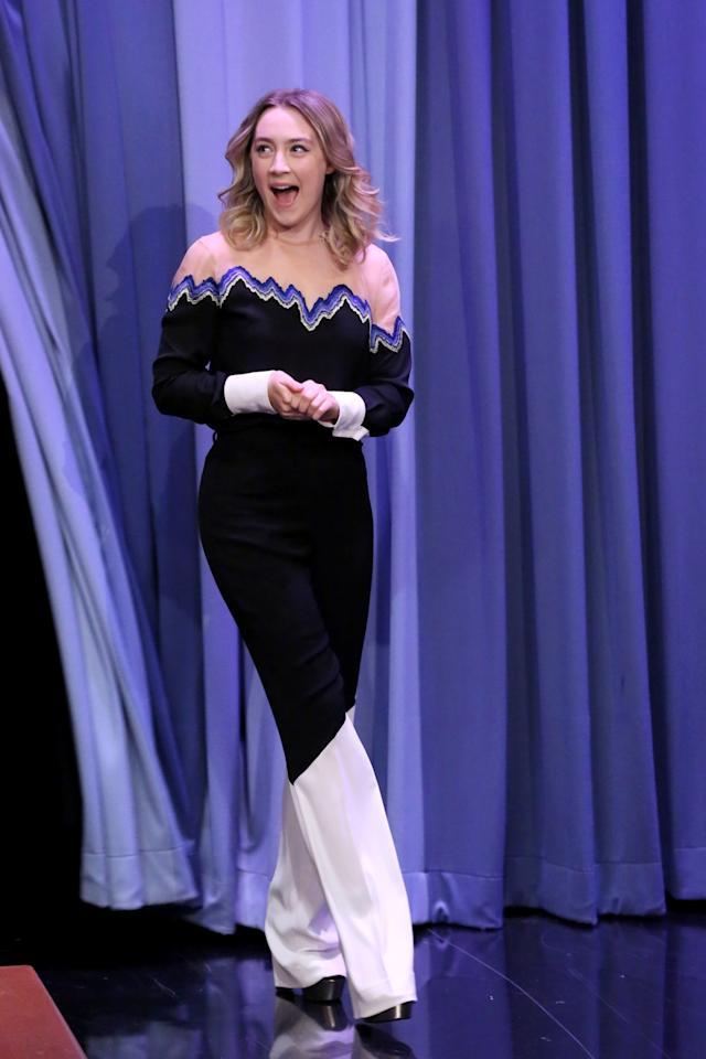 <p>Saorise Ronan threw down the gauntlet on Thursday night, making the jumpsuit battle of 2015 one of the most epic East Coast vs. West Coast battles of all time. Promoting her new film <i>Brooklyn</i>, the Irish actress wore a one-piece made of two-toned black and white pants, a top with sheer shoulders, and a rainbow zig zag pattern running underneath it along the collarbone line.<i>Photo: Getty Images</i></p>