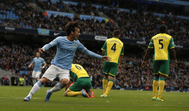 """Manchester City's David Silva (L) celebrates after scoring his side's second goal during their English Premier League soccer match against Norwich City at the Etihad Stadium in Manchester, northern England November 2, 2013. REUTERS/Phil Noble (BRITAIN - Tags: SPORT SOCCER) FOR EDITORIAL USE ONLY. NOT FOR SALE FOR MARKETING OR ADVERTISING CAMPAIGNS. NO USE WITH UNAUTHORIZED AUDIO, VIDEO, DATA, FIXTURE LISTS, CLUB/LEAGUE LOGOS OR """"LIVE"""" SERVICES. ONLINE IN-MATCH USE LIMITED TO 45 IMAGES, NO VIDEO EMULATION. NO USE IN BETTING, GAMES OR SINGLE CLUB/LEAGUE/PLAYER PUBLICATIONS"""