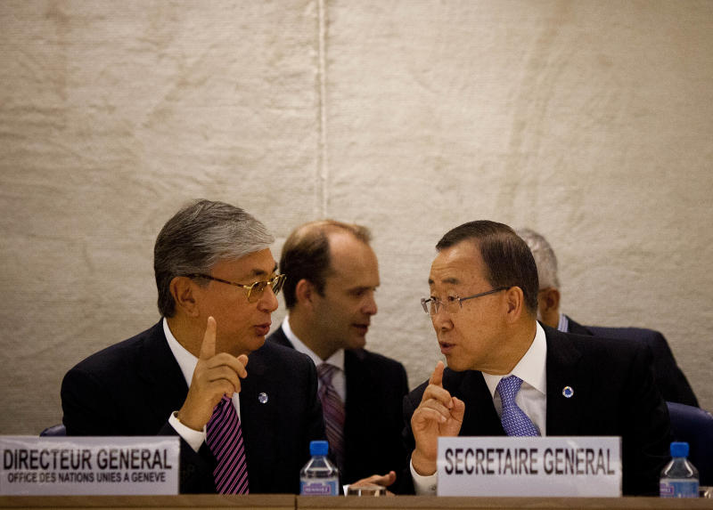 Kassym-Zhomart Kemelevich Tokaev, left, Director-General of the United Nations Office at Geneva, talks to U.N. Secretary-General Ban Ki-moon during the Human Rights Council at the United Nations in Geneva, Switzerland, Monday, Sept. 10, 2012. Ban Ki-moon is urging the world's foremost human rights body to keep up the pressure on major powers to end the civil war in Syria and outbreak of human abuses there. (AP Photo/Anja Niedringhaus)