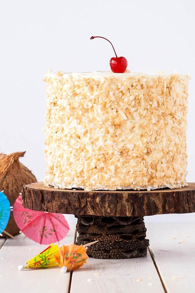 "<p>This rum-flavored cake is the ultimate tropical dessert. It's made with a pineapple filling and is topped with toasted coconut. </p><p><strong>Get the recipe at <a rel=""nofollow"" href=""https://livforcake.com/pina-colada-cake/"">Liv for Cake</a>. </strong></p>"