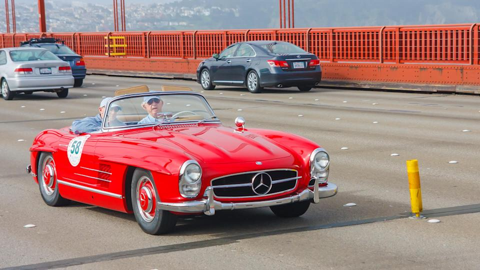 SAN FRANCISCO - APRIL 30: A 1958 Mercedes Benz 300SL Roadster is being driven on Golden Gate Bridge during the 2012 California Mille race in San Francisco on April 30, 2012.