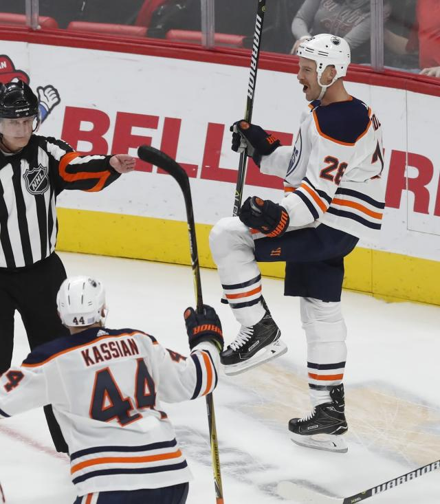 Edmonton Oilers center Kyle Brodziak (28) celebrates after a goal during the third period of an NHL hockey game against the Detroit Red Wings, Saturday, Nov. 3, 2018, in Detroit. (AP Photo/Carlos Osorio)