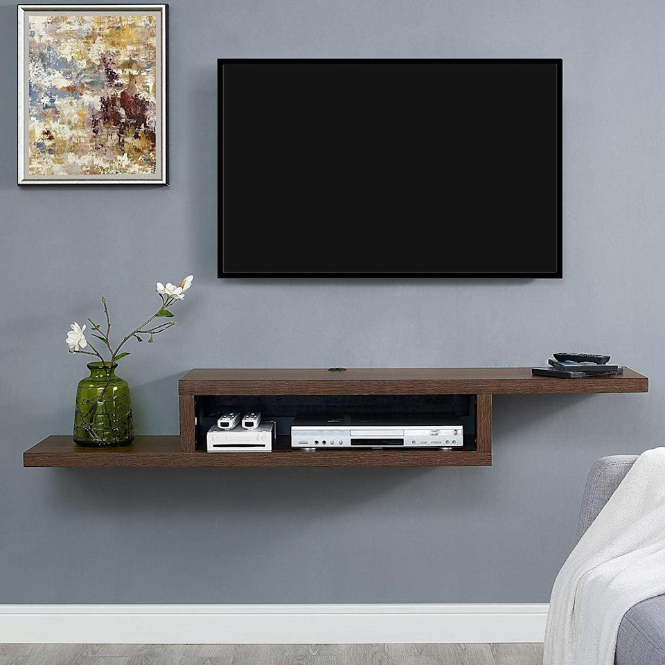 <p>Keep your entertainment area organized with this sleek <span>Martin Furniture Asymmetrical Wall-Mounted Console</span> ($157, originally $169).</p>