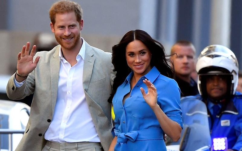 The Duke and Duchess of Sussex, Prince Harry and his wife Meghan, pictured arriving at District Six in Cape Town, on the first day of their South African tour in September 2019 - Reuters