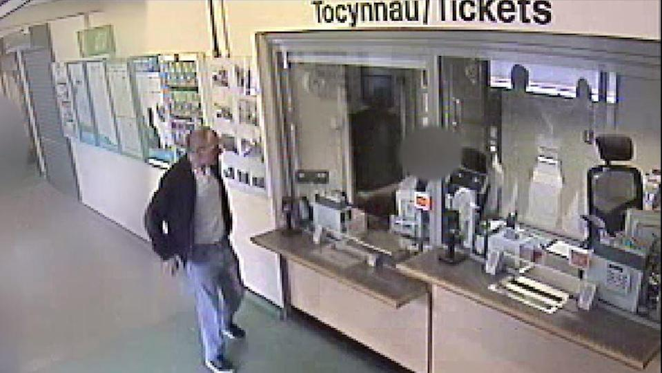 David Gaut, 54, is seen buying tickets at a train station in Caerphilly just hours before his death.