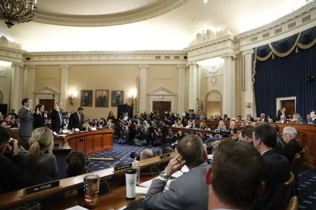 Constitutional law experts rise to be sworn in during a hearing before the House judiciary committee