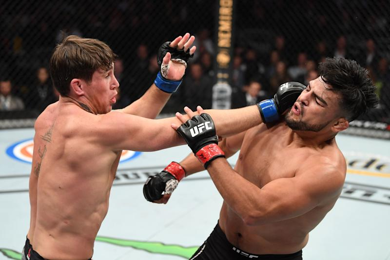 NEW YORK, NEW YORK - NOVEMBER 02: (L-R) Darren Till of England punches Kelvin Gastelum in their middleweight bout during the UFC 244 event at Madison Square Garden on November 02, 2019 in New York City. (Photo by Josh Hedges/Zuffa LLC via Getty Images)