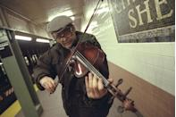 <p>John Arms, a subway violinist street performer, plays in the Christopher St. station for an extra buck.</p>