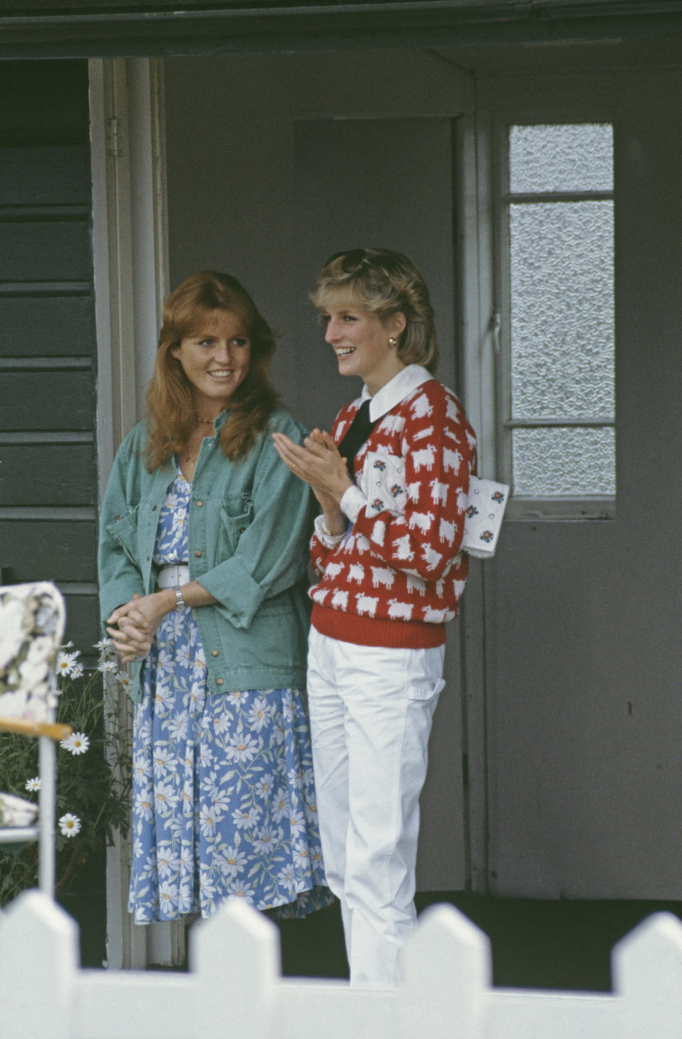 Diana, Princess of Wales  (1961 - 1997) and her friend Sarah Ferguson attend a polo match at Smith's Lawn, Guards Polo Club, Windsor, June 1983. Diana is wearing a Muir and Osborne 'black sheep' sweater. (Photo by Princess Diana Archive/Getty Images)