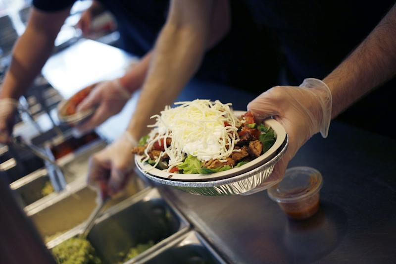 An employee prepares a burrito bowl at a Chipotle Mexican Grill Inc. restaurant in Louisville, Kentucky, U.S., on Saturday, Feb. 2, 2019. Chipotle Mexican Grill Inc. is scheduled to release earnings figures on February 6. Photographer: Luke Sharrett/Bloomberg via Getty Images