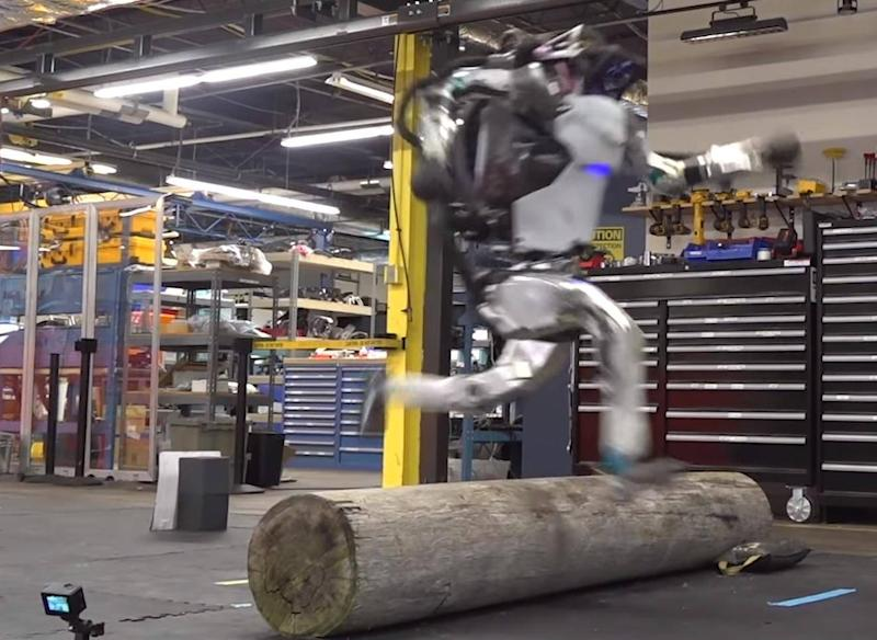 A still from the video showing the Atlas robot jumping over a log (Boston Dynamics)