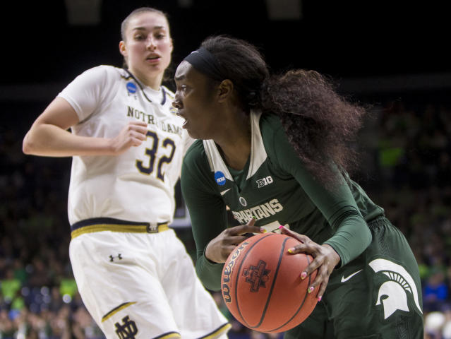 Michigan State's Victoria Gaines, right, drives by Notre Dame's Jessica Shepard (32) during a second-round game in the NCAA women's college basketball tournament in South Bend, Ind., Monday, March 25, 2019. (AP Photo/Robert Franklin)