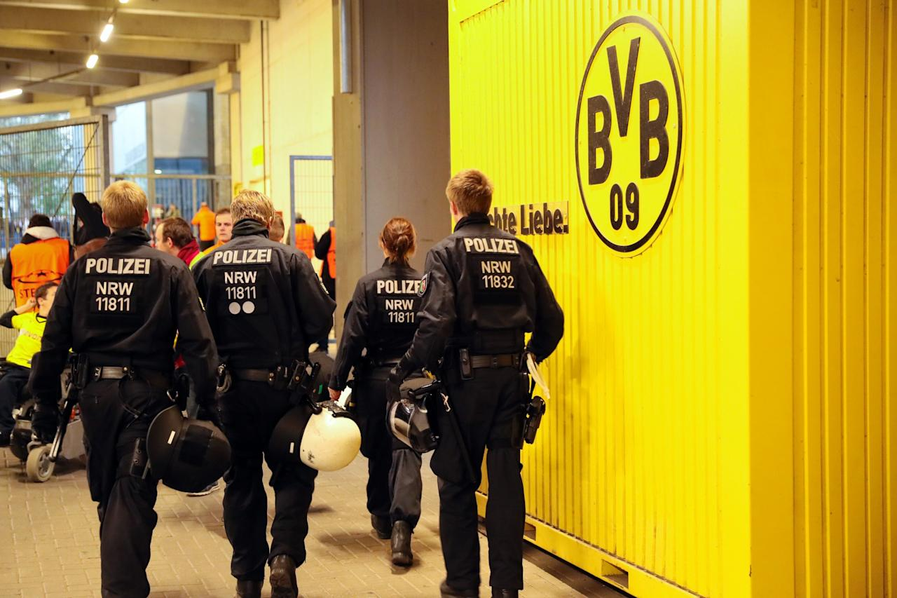 <p>Police under the main tribune at the UEFA Champions League Quarter Final first leg match between Borussia Dortmund and AS Monaco at Signal Iduna Park on April 11, 2017 in Dortmund, Germany. (Photo by Matthew Ashton – AMA/Getty Images) </p>