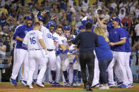 Members of the Los Angeles Dodgers celebrate as Will Smith, second from left, score after hitting a three-run walk off home run during the ninth inning of a baseball game against the San Francisco Giants Tuesday, July 20, 2021, in Los Angeles. (AP Photo/Mark J. Terrill)
