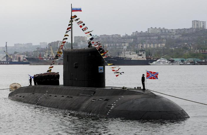 The crew of the Varshavyanka class diesel submarine take part at the Victory Day parade in Vladivostok, Russia, May 9, 2015. Russia marks the 70th anniversary of the end of World War Two in Europe on Saturday with a military parade, showcasing new militar