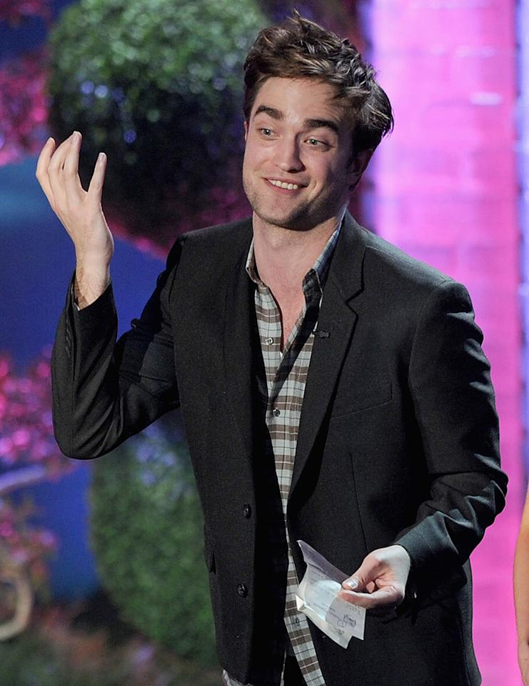 """<i>Us Weekly</i> reveals that Robert Pattinson is going """"to record an album imminently."""" The actor, who recorded two songs featured on the original """"Twilight"""" soundtrack, """"has been kicking a few original songs around for a long time,"""" notes the magazine. For more exclusive scoop on the solo album and when it's slated to be released, see what a Pattinson insider confirms to <a href=""""http://www.gossipcop.com/robert-pattinson-recording-album-record-new-music-songs-cd-studio-2011/"""" target=""""new"""">Gossip Cop</a>. Kevin Winter/<a href=""""http://www.gettyimages.com/"""" target=""""new"""">GettyImages.com</a> - June 5, 2011"""