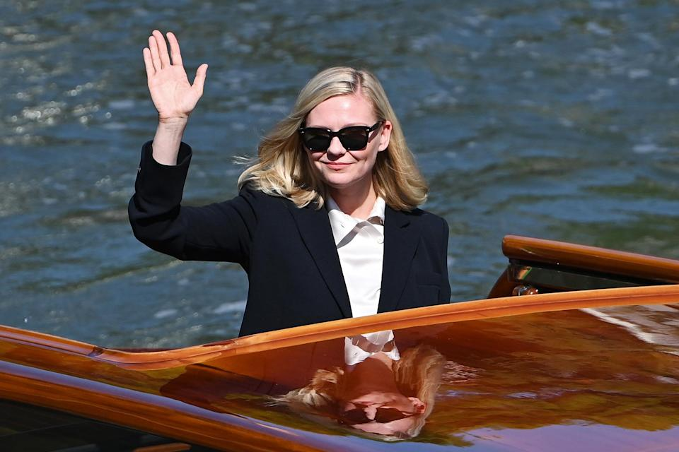 <p>Kirsten Dunst waved to the crowd while arriving at the festival on Sept. 2. </p>
