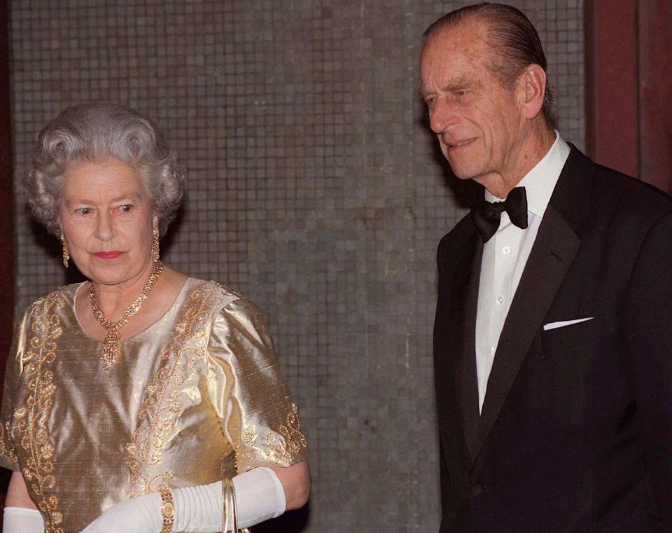 <p>For Queen Elizabeth and Prince Philip's golden wedding anniversary celebration in November 1997, she chose an all gold ensemble and accessories. <br></p>