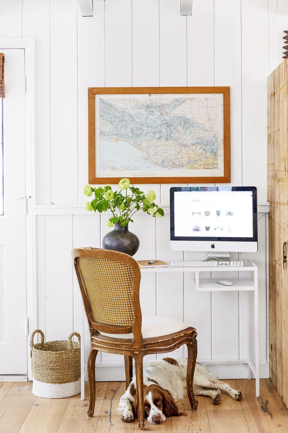 """<p>To mix warm and cool tones, pair a minimalistic white desk with a contrasting antique chair. Decorate with baskets, paintings, or accessories that combine the two colors.</p><p><strong>RELATED: </strong><a href=""""https://www.goodhousekeeping.com/home/decorating-ideas/a32824185/minimalist-living/"""" rel=""""nofollow noopener"""" target=""""_blank"""" data-ylk=""""slk:What Is Minimalist Living? Here's How to Start Living With Less, According to Experts"""" class=""""link rapid-noclick-resp"""">What Is Minimalist Living? Here's How to Start Living With Less, According to Experts</a></p>"""
