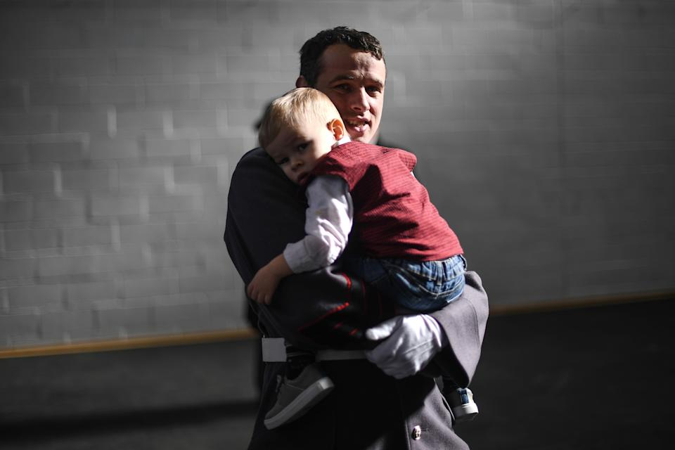 WINDSOR, ENGLAND - MARCH 01: A member of the Welsh Guards holds his son at Windsor Barracks on St David's Day on March 1, 2020 in Windsor, England. The 1st Battalion Welsh Guards marked their first St David's Day at Windsor Barracks with a church service before being presented with leeks. During the church service they rededicated the Falkland's Cross, which was made during the conflict by survivors of HMS Sir Galahad, before being brought back by the Welsh Guards. (Photo by Peter Summers/Getty Images)