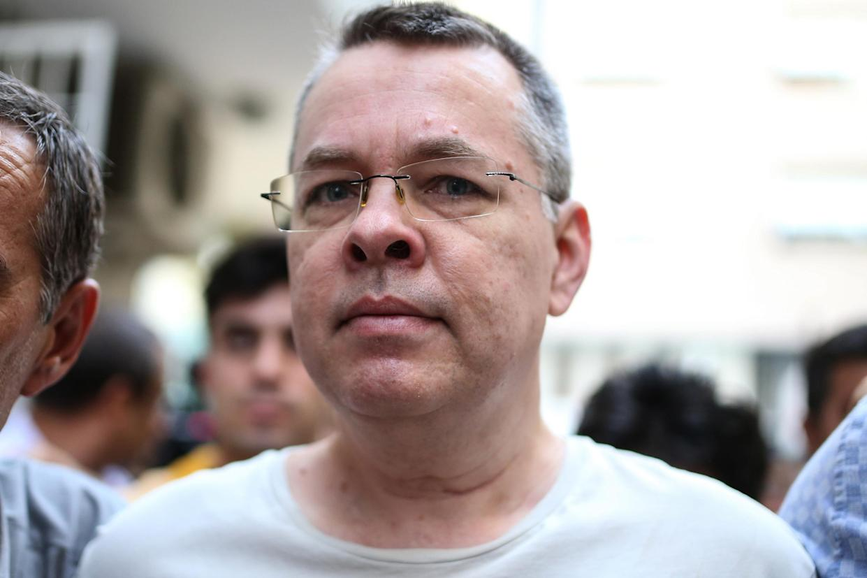 US pastor Andrew Craig Brunson, here escorted by plain clothes police officers on his transfer from prison to house arrest on 25 July 2018 in Izmir, Turkey: AFP/Getty