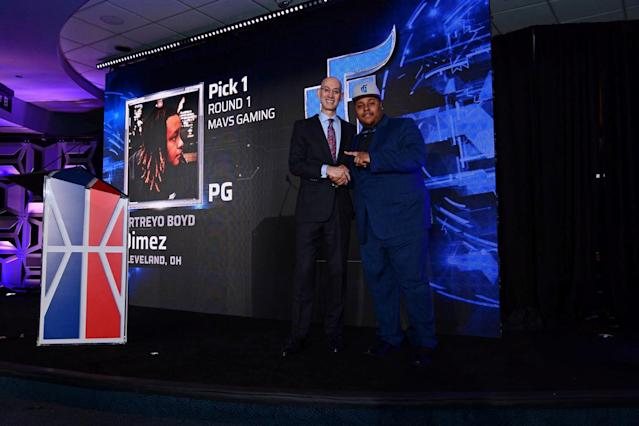"NBA Commissioner Adam Silver (L) stands with Artreyo ""Dimez"" Boyd, who was selected first overall by the Dallas Mavericks' Mavs Gaming at the NBA 2K league draft, in New York, New York, U.S., April 4, 2018. Picture taken April 4, 2018. NBA 2K League/Handout via Reuters ATTENTION EDITORS - THIS IMAGE WAS PROVIDED BY A THIRD PARTY NO RESALES, NO ARCHIVE"