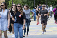 People go massless on the Atlanta Beltline on Friday, May 14, 2021, after the CDC updated their mask guidelines for COVID-19 vaccinated people. (AP Photo/Ben Gray)