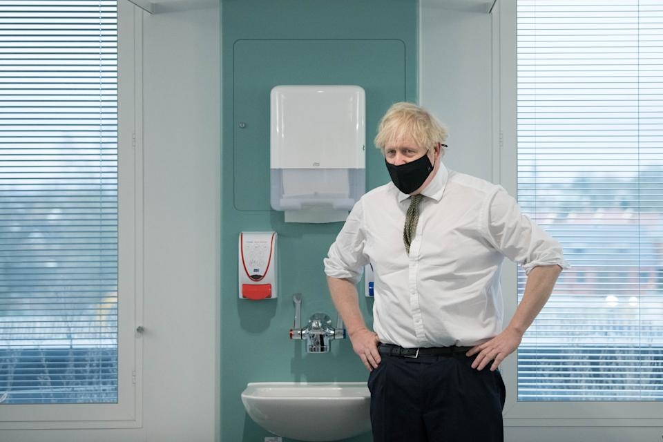 Prime Minister Boris Johnson during a visit to view the vaccination programme at Chase Farm Hospital in north London, part of the Royal Free London NHS Foundation Trust. The NHS is ramping up its vaccination programme with 530,000 doses of the newly approved Oxford/AstraZeneca Covid-19 vaccine jab available for rollout across the UK.