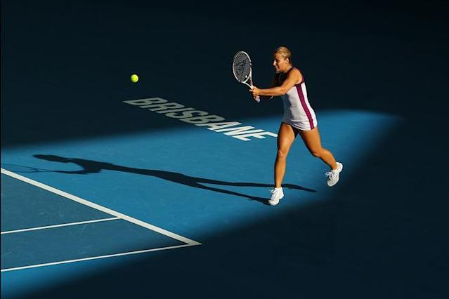 BRISBANE, AUSTRALIA - JANUARY 01: Dominika Cibulkova of Serbia plays a shot during her match against Daniela Hantuchova of Serbia during day one of the 2012 Brisbane International at Pat Rafter Arena on January 1, 2012 in Brisbane, Australia. (Photo by Chris Hyde/Getty Images)