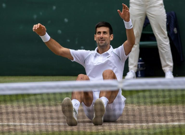 Serbia's Novak Djokovic, celebrating his Wimbledon finals victory, tries to complete a calendar-year Grand Slam by winning the US Open, which begins Monday in New York