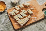 """These cookie bars are studded with the best parts of traditional fruitcake (orange zest and dried fruit) and spiced up with lots of fresh ginger. The white chocolate drizzle creates a blank canvas that's perfect for sprinkles and/or sanding sugar. <a href=""""https://www.epicurious.com/recipes/food/views/white-chocolate-fruitcake-bars?mbid=synd_yahoo_rss"""" rel=""""nofollow noopener"""" target=""""_blank"""" data-ylk=""""slk:See recipe."""" class=""""link rapid-noclick-resp"""">See recipe.</a>"""
