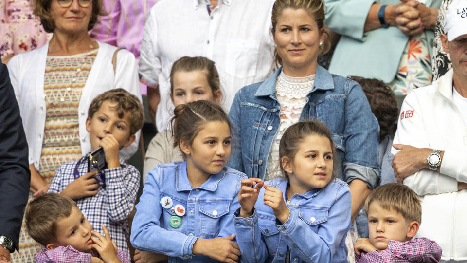 Mirka Federer, pictured here with her four children watching Roger at Wimbledon in 2019.