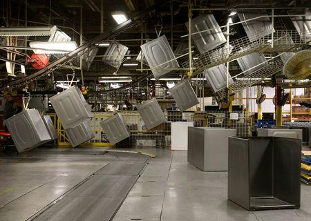 FILE PHOTO: Washing machine cabinets move along a conveyor belt waiting to be assembled  at a Whirlpool plant in Clyde