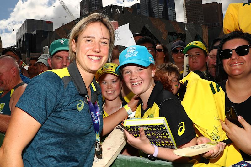 Ellyse Perry of the Australian Women's T20 World Cup team greets supporters after winning the ICC Women's T20 World Cup Final.