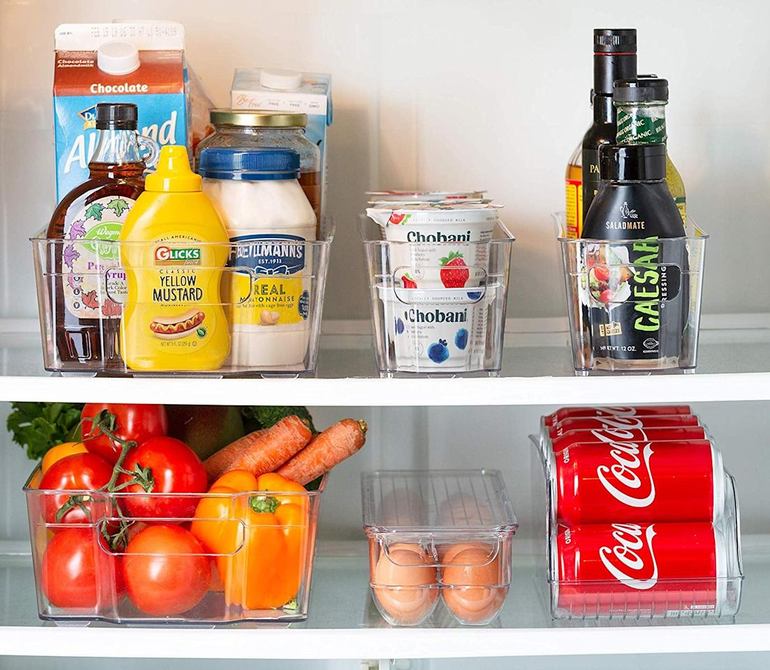 """<p>These <a href=""""https://www.popsugar.com/buy/Refrigerator-Stackable-Storage-Organizer-Bins-484622?p_name=Refrigerator%20Stackable%20Storage%20Organizer%20Bins&retailer=walmart.com&pid=484622&price=34&evar1=savvy%3Auk&evar9=46557269&evar98=https%3A%2F%2Fwww.popsugar.com%2Fsmart-living%2Fphoto-gallery%2F46557269%2Fimage%2F46557834%2FRefrigerator-Stackable-Storage-Organizer-Bins&list1=shopping%2Corganization%2Ckitchen%20organization%2Chome%20organization%2Chome%20shopping&prop13=api&pdata=1"""" rel=""""nofollow"""" data-shoppable-link=""""1"""" target=""""_blank"""" class=""""ga-track"""" data-ga-category=""""Related"""" data-ga-label=""""https://www.walmart.com/ip/Dispenser-Set-Organizer-Containers-Freezer-Fridge-With-Includes-Board-Fridge-Kitchen-Piece-Egg-Magnet-Included-For-Refrigerator-Marker-Can-Tray-Bins-/758468763"""" data-ga-action=""""In-Line Links"""">Refrigerator Stackable Storage Organizer Bins</a> ($34) come in several different shapes and sizes.</p>"""