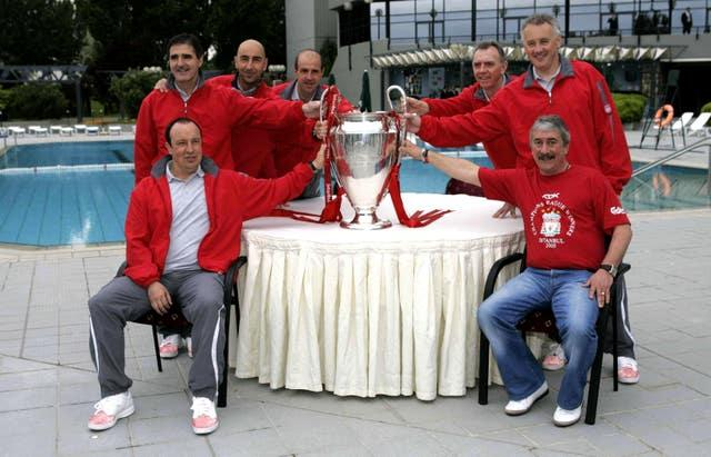 Parry, back right, and Benitez, front left, and former Liverpool chairman David Moores, front right, pose with the Champions League trophy in 2005