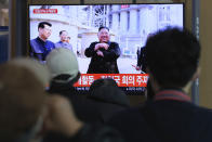 People watch a TV showing an image of North Korean leader Kim Jong Un during a news program at the Seoul Railway Station in Seoul, South Korea, Saturday, May 2, 2020. Kim made his first public appearance in 20 days as he celebrated the completion of a fertilizer factory near Pyongyang, state media said Saturday, ending an absence that had triggered global rumors that he was seriously ill. (AP Photo/Ahn Young-joon)