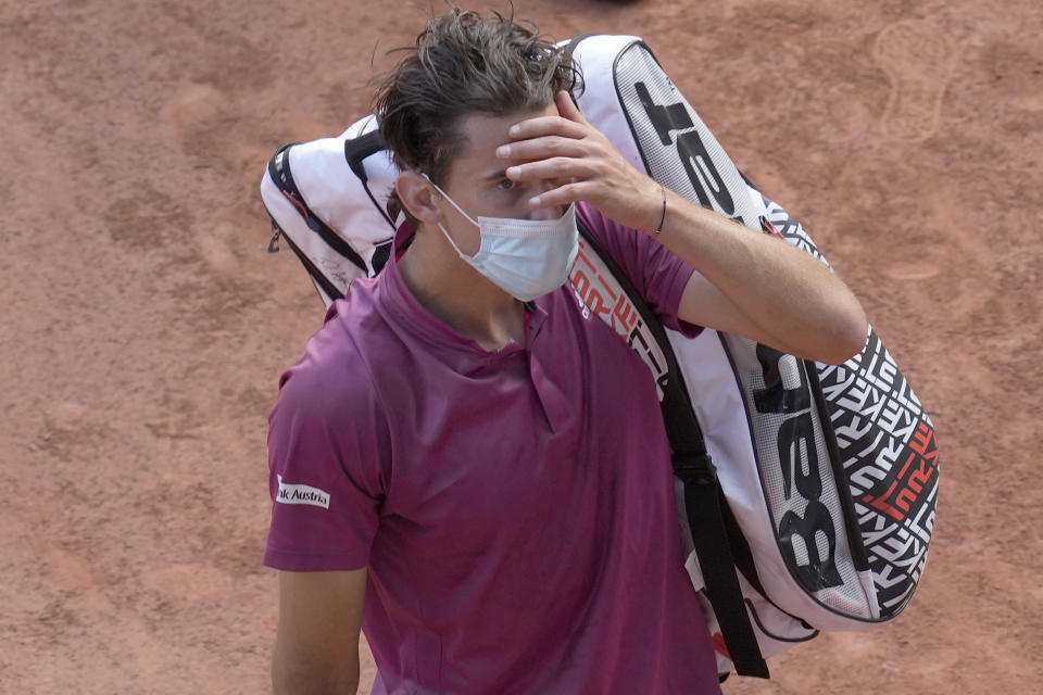 Austria's Dominic Thiem walks off the court after losing to Spain's Pablo Andujar in their first round match of the French Open tennis tournament at the Roland Garros stadium Sunday, May 30, 2021 in Paris. (AP Photo/Christophe Ena)