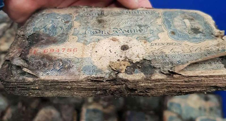 All of the money was covered in dirt and debris when it was pulled from beneath the floorboards and is now in the possession of Sussex Police for safekeeping. Source: Sussex Police