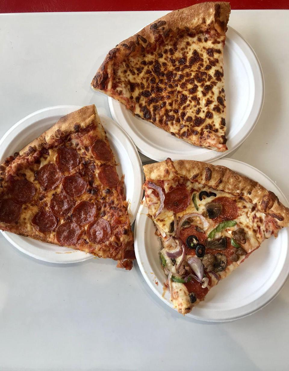 <p>You can get Costco's pizza by the slice, but I watched a bunch of people carry out an entire box...and I get it! The slices are huge and the pizza is super soft and dough-y, which sometimes is a problem, but Costco makes it work.</p><p> It's also very cheesy, especially the plain cheese (duh), and the pepperonis have a nice lil' spice to them. The combo slice is topped with sausage, pepperoni, green pepper, red onion, mushrooms, and olives, and it's filling + satisfying. The pizza is ALWAYS a good option!</p>