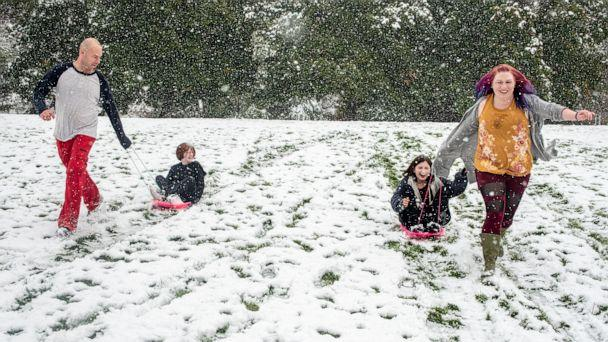 PHOTO: From left, Tommy Little, Cody Little, Kyndra Neal and Tanya Little sled down a hill in Missoula, Mont., Sept. 29, 2019 after snow in an early winter storm. ((Ben Allan Smith/The Missoulian via AP)