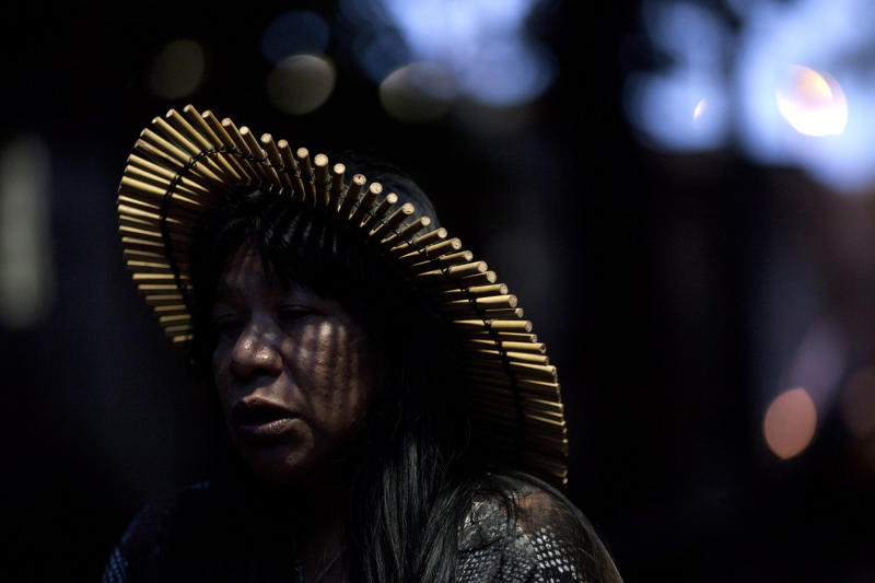 """An indigenous woman participates in a protest at a building known as the """"Old Indian Museum,"""" located near the Maracana stadium in Rio de Janeiro, Brazil, during the United Nations Conference on Sustainable Development, or Rio+20, Thursday June  21, 2012. Indigenous people who have built homes at the building will be relocated due to works on the stadium and the surrounding area as part of Brazil's preparations for the 2014 World Cup. (AP Photo/Felipe Dana)"""