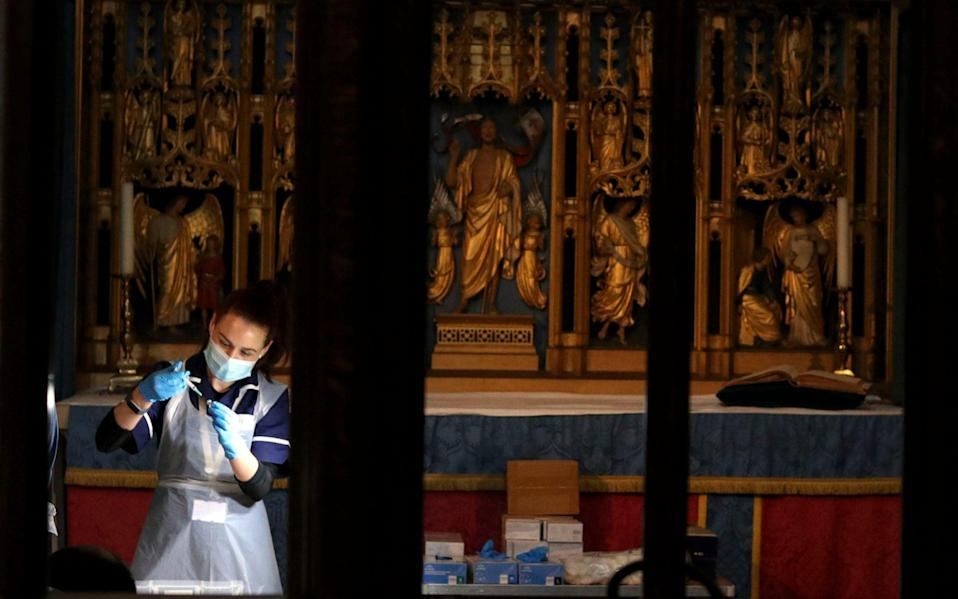 The Pfizer coronavirus vaccine is prepared by health workers at Salisbury Cathedral - Steve Parsons/PA