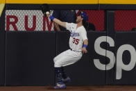 Los Angeles Dodgers center fielder Cody Bellinger can't gets a glove on a double by Tampa Bay Rays' Joey Wendle during the seventh inning in Game 1 of the baseball World Series Tuesday, Oct. 20, 2020, in Arlington, Texas. (AP Photo/Tony Gutierrez)