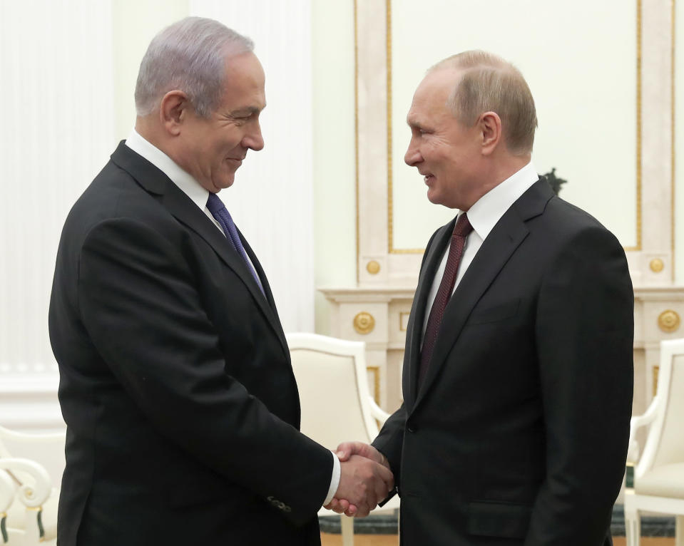 Russian President Vladimir Putin, right, shakes hands with Israeli Prime Minister Benjamin Netanyahu during their meeting in the Kremlin in Moscow, Russia, Wednesday, Feb. 27, 2019. The talks are expected to focus on the situation in Syria. (Maxim Shemetov/Pool Photo via AP)