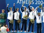 <p>Michael Phelps, Ryan Lochte, Peter Vanderkaay, and Klete Keller win gold in the Men's 4 x 200-meter freestyle relay at the Athens 2004 Olympics. (Chris Ivin/WireImage)</p>