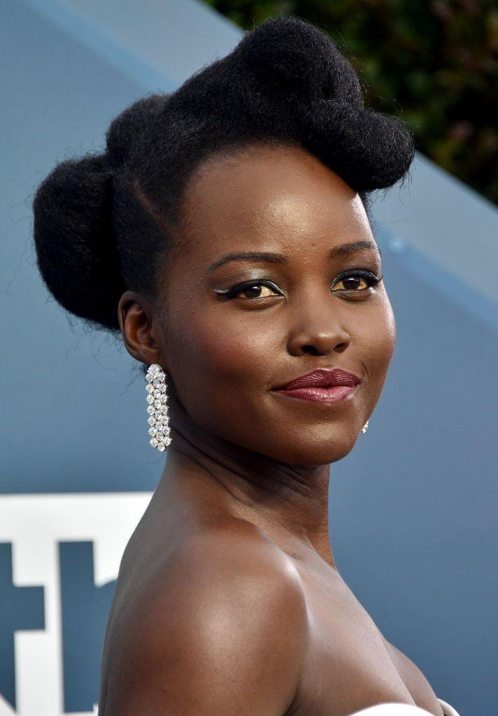<p>Lupita Nyong'o's plum shade of lipstick falls right in the middle of the spectrum between neutral and bold. Combined with silver eyeshadow, it gives just enough wow! </p>