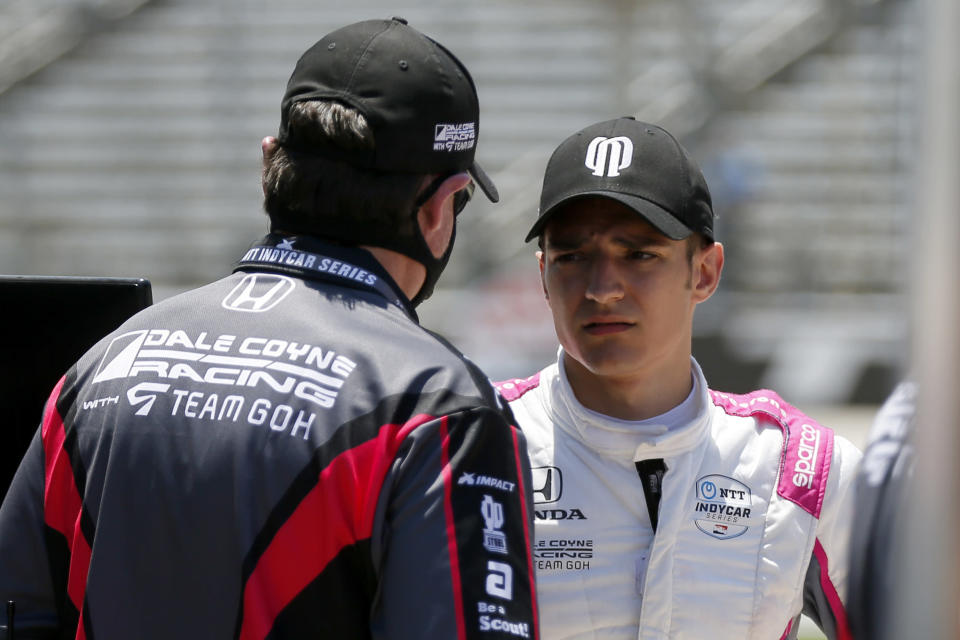 Alex Palou, right, talks with a team member during practice for the IndyCar auto race at Texas Motor Speedway in Fort Worth, Texas, Saturday, June 6, 2020. (AP Photo/Tony Gutierrez)