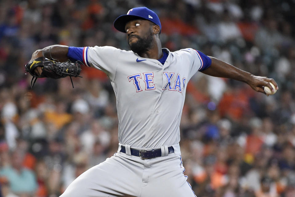 Texas Rangers starting pitcher Taylor Hearn delivers during the first inning of a baseball game against the Houston Astros, Sunday, July 25, 2021, in Houston. (AP Photo/Eric Christian Smith)